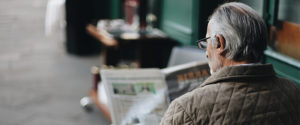 Man reading news paper about financial mistakes before retirement
